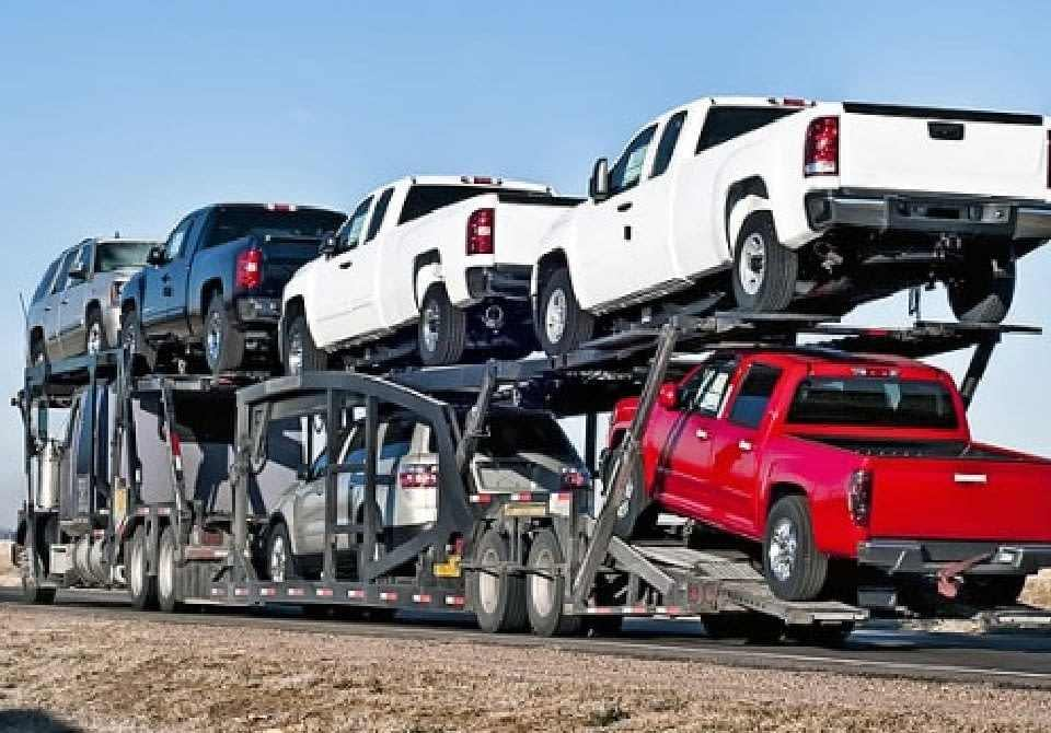 trailer truck with cars cargo